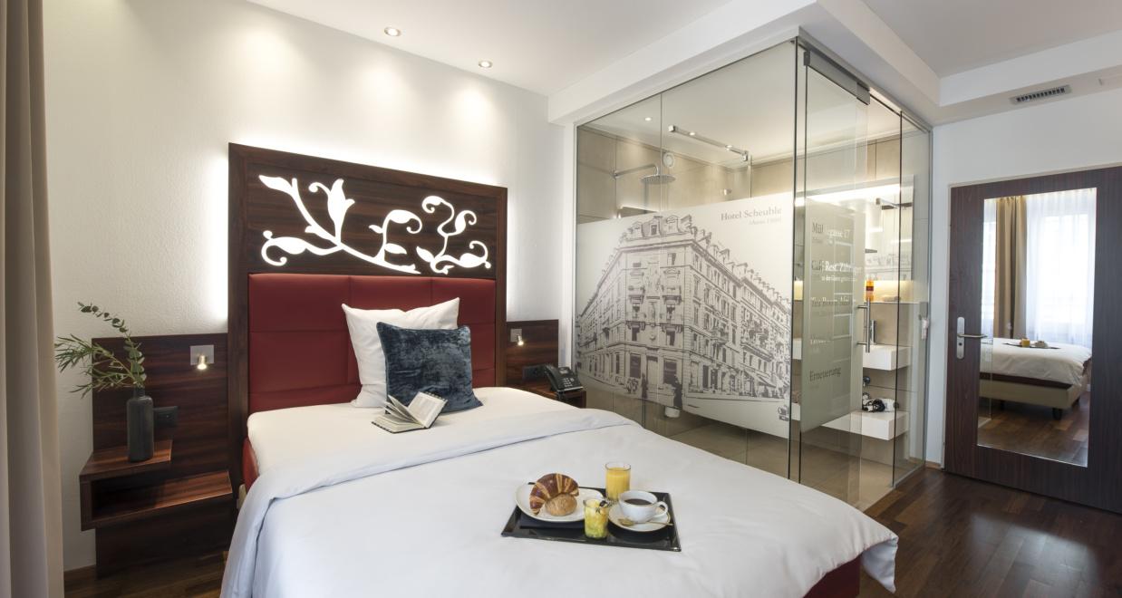 Schönes Einzelzimmer von Hotel Scheuble bei dem man günstige Zimmer buchen kann